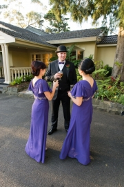 Best man having a drink with the ladies